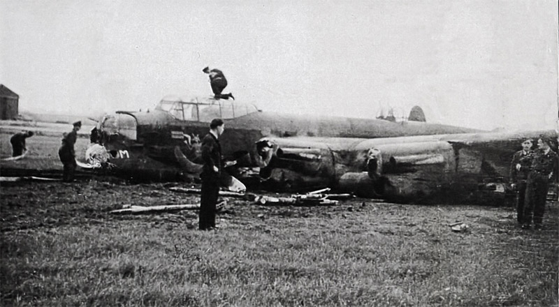 A crashed Lancaster on an RAF airfield