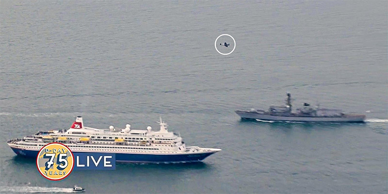 MV Boudicca sailing from Portsmouth to Normandy and BBMF Spitfire PRXIX PM631 conducting a flypast