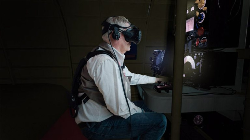 Sitting at the Lancaster's wireless operator's desk wearing a haptic vest and a virtual reality headset