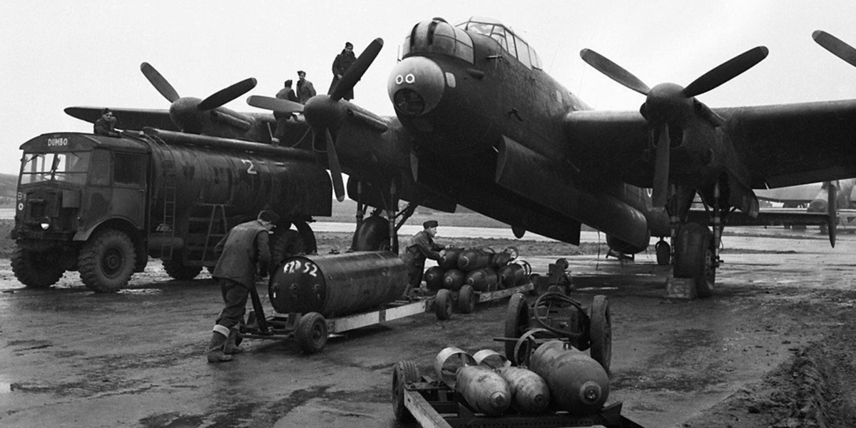 Ground crew refuelling and bombing-up a Lancaster of 75 (NZ) Sqn.