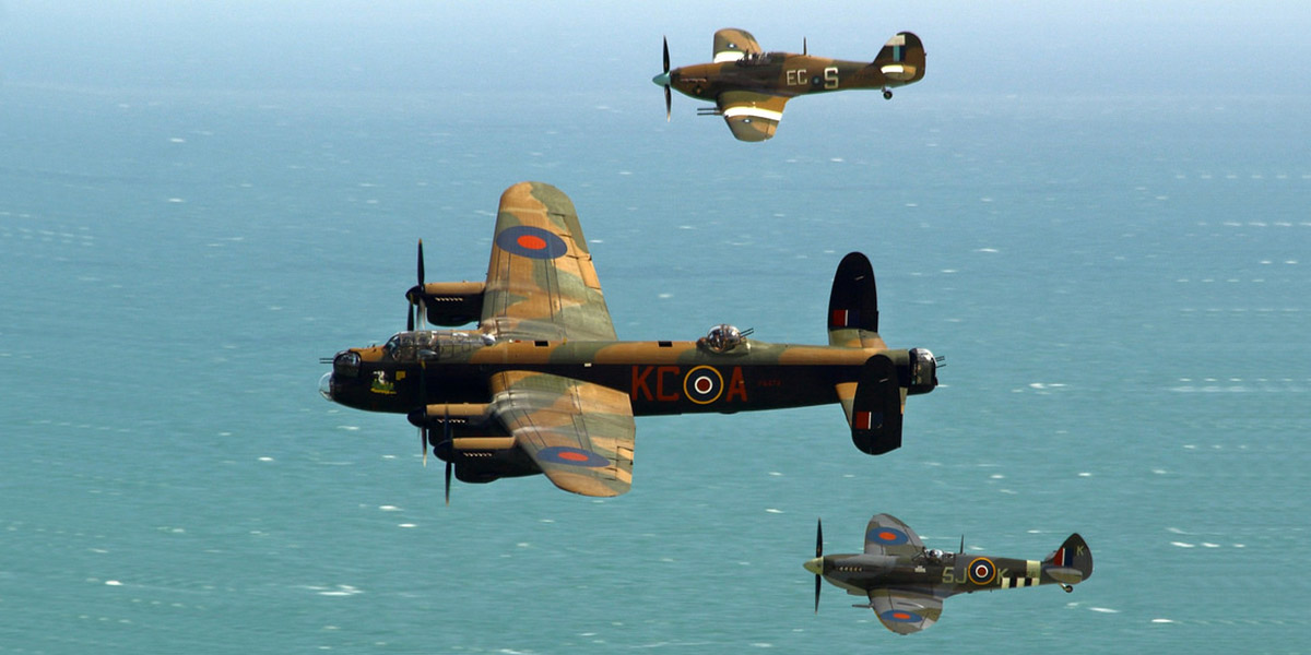 The BBMF three-ship formation of the Lancaster, Spitfire Mk IXe MK356 and Hurricane Mk IIC PZ865 rounds Beachy Head on the run in to Eastbourne to display.