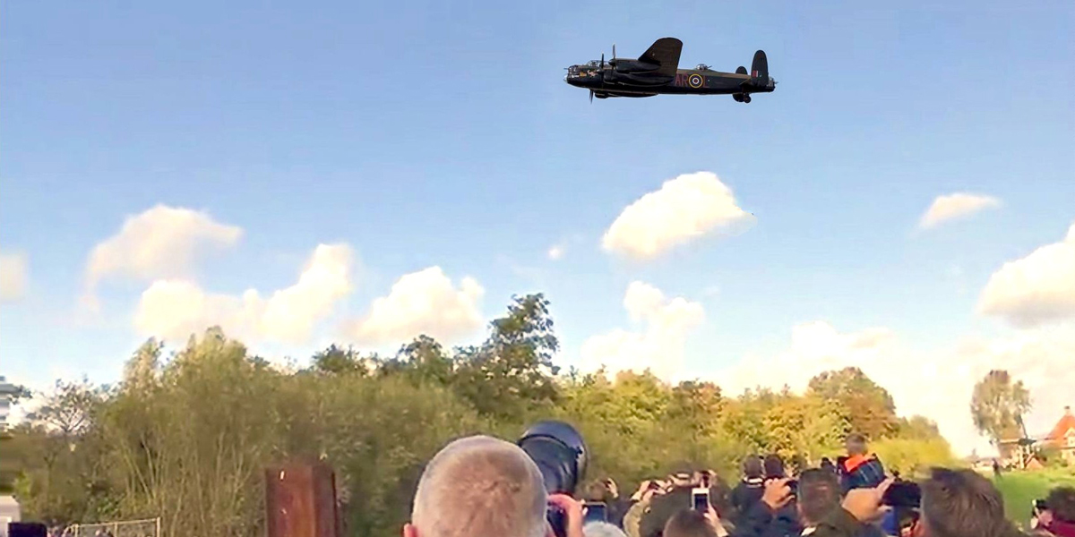 BBMF Lancaster PA474 flies over the recovery site of Lancaster R5682